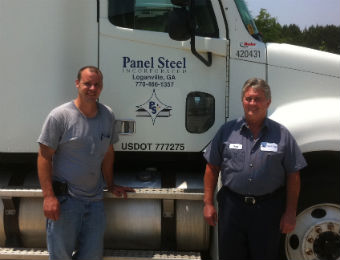 Panel Steel personnel by truck